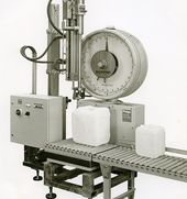 The first canister filling machine